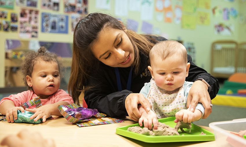 Why early childhood education matters - teacher with two children